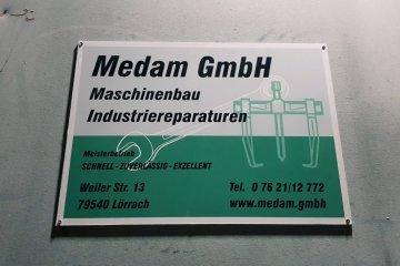 Medam GmbH in Lörrach Firmenschild an neuem Standort